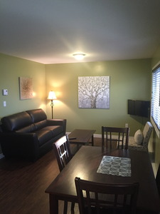 Property: Berry Heights Suites | Room Type: 2-Bedroom Suite Photo 1